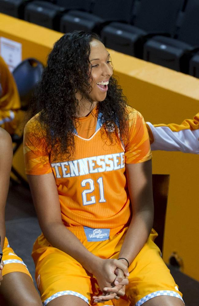 Tennessee assistant coach Dean Lockwood, right, greets freshman Jordan Reynolds, left, and Mercedes Russell during NCAA college basketball media day Wednesday, Oct. 30, 2013, in Knoxville, Tenn