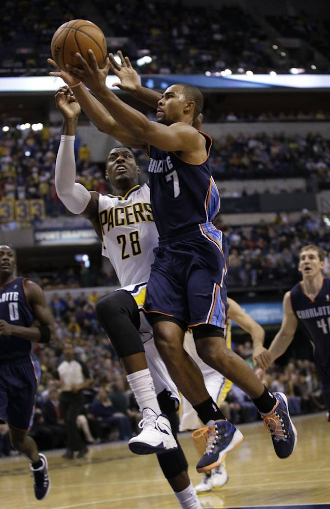 Charlotte Bobcats guard Ramon Sessions, right, shoots infront of Indiana Pacers center Ian Mahinmi during the first half of an NBA basketball game in Indianapolis, Friday, Dec. 13, 2013