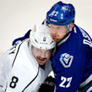 Los Angeles Kings' Drew Doughty, left, and Vancouver Canucks' Daniel Sedin, of Sweden, battle for position in front of the Kings' net during the second period of an NHL hockey game, in Vancouver, British Columbia, Monday Nov. 25, 2013 The Associated Press