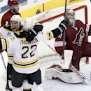 Boston Bruins' Shawn Thornton (22) celebrates his goal against Phoenix Coyotes' Mike Smith, right, with teammate Gregory Campbell (11) as Coyotes' Keith Yandle (3) skates past during the third period of an NHL hockey game Saturday, March 22, 2014, in Glen