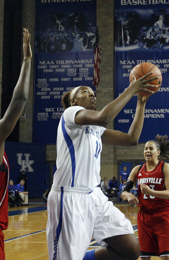 Kentucky's DeNesha Stallworth (11) shoots between, from left, Louisville defenders Antonita Slaughter, Asia Taylor (31), Shoni Schimmel (23) and Louisville's Bria Smith during the second half of an NCAA college basketball game, Sunday, Dec. 1, 2013, in Lexington, Ky. Kentucky won 69-64