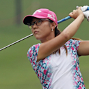 Lydia Ko of New Zealand watches her shot on the 18th hole during the second round of the LPGA Malaysia golf tournament at Kuala Lumpur Golf and Country Club in Kuala Lumpur, Malaysia, Friday, Oct. 10, 2014. (AP Photo/Lai Seng Sin)