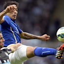 Leicester's Leonardo Ulloa, top, and Newcastle United's Steven Taylor battle for the ball during their English Premier League soccer match at St. James' Park, Newcastle, England, Saturday, Oct. 18, 2014