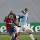 CSKA's Bebras Natcho, left, vies for the ball with Manchester City's Edin Dzeko during the Champions League Group E soccer match between CSKA Moscow and Manchester City at Arena Khimki stadium in Moscow, Russia, Tuesday Oct. 21, 2014