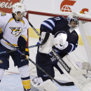 Nashville Predators' Colin Wilson's deflection goes off the mask of Winnipeg Jets goaltender Ondrej Pavelec (31) during the third period of an NHL hockey game Friday, Oct. 17, 2014, in Winnipeg, Manitoba The Associated Press