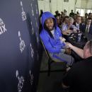Seattle Seahawks' Richard Sherman answers a question at a news conference for NFL Super Bowl XLIX football game Sunday, Jan. 25, 2015, in Phoenix. The Seahawks play the New England Patriots in Super Bowl XLIX on Sunday, Feb. 1, 2015. (AP Photo/David J. Phillip)