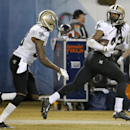 New Orleans Saints free safety Pierre Warren right runs after intercepting a pass intended for Chicago Bears wide receiver Alshon Jeffery (17) during the second half of an NFL football game Monday, Dec. 15, 2014, in Chicago The Associated Press