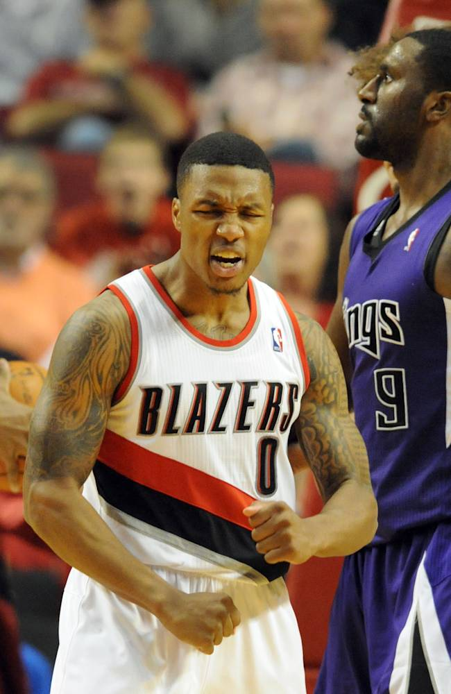Portland Trail Blazers guard Damian Lillard (0) react after scoring during the second half of an NBA basketball game against the Sacramento Kings on Sunday, Oct. 20, 2013, in Portland. Portland won 109-105