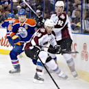 Colorado Avalanche's Paul Stastny (26) and Gabriel Landeskog (92) battle for the puck with Edmonton Oilers' Andrew Ference (21) during first-period NHL hockey game action in Edmonton, Alberta, Thursday, Dec. 5, 2013 The Associated Press