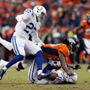Denver Broncos strong safety Omar Bolden (31) tackles Indianapolis Colts wide receiver Josh Cribbs (16) as Colts' Josh Gordy (27) defends during the first half of an NFL divisional playoff football game, Sunday, Jan. 11, 2015, in Denver The Associated Pre