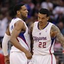Los Angeles Clippers forward Danny Granger, left, body bumps to congratulate forward Matt Barnes (22) on making a three-point shot to end the third quarter in an NBA basketball game against Phoenix Suns Monday, March 10, 2014, in Los Angeles. Clippers won
