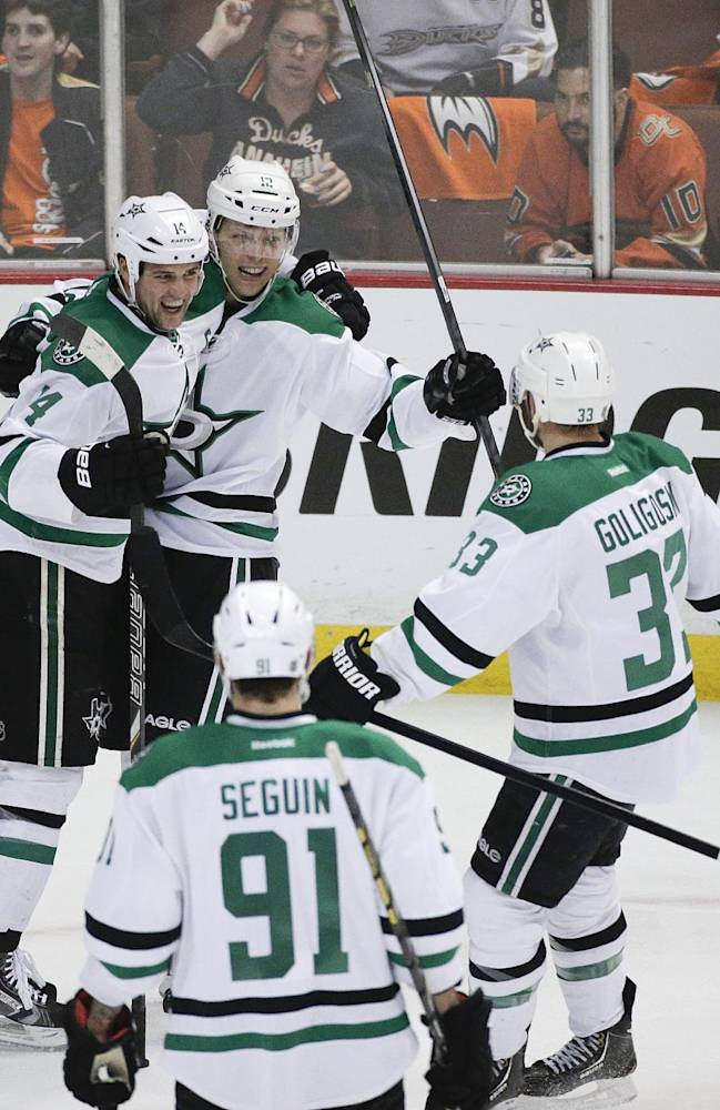 Dallas Stars' Alex Chiasson (12) celebrates his goal with Jamie Benn (14), Alex Goligoski (33) and Tyler Seguin (91) during the first period in Game 2 of the first-round NHL hockey Stanley Cup playoff series against the Anaheim Ducks on Friday, April 18, 2014, in Anaheim, Calif