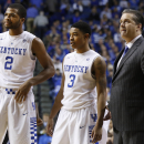From left, Kentucky's Aaron Harrison, Tyler Ulis, and head coach John Calipari pause for a moment during the second half of an NCAA college basketball game, Saturday, Dec. 13, 2014. Kentucky won 84-70. (AP Photo/James Crisp)