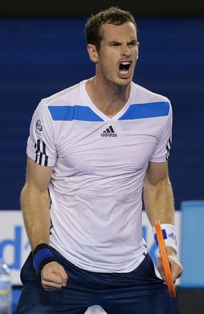 Andy Murray of Britain celebrates after winning his second round match against Vincent Millot of France at the Australian Open tennis championship in Melbourne, Australia, Thursday, Jan. 16, 2014