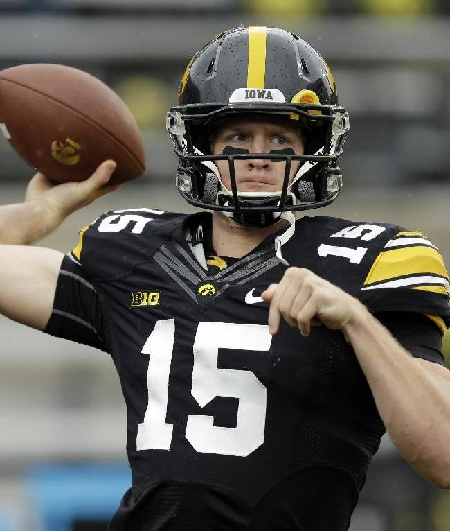 Iowa quarterback Jake Rudock warms up before an NCAA college football game against Michigan State, Saturday, Oct. 5, 2013, in Iowa City, Iowa