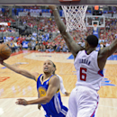 Golden State Warriors guard Stephen Curry, left, puts up a shot as Los Angeles Clippers center DeAndre Jordan defends during the first half in Game 1 of an opening-round NBA basketball playoff series, Saturday, April 19, 2014, in Los Angeles The Associate