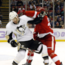 Pittsburgh Penguins right wing Pascal Dupuis (9) battles with Detroit Red Wings defenseman Kyle Quincey (27) in the first period of an NHL hockey game in Detroit, Thursday, Oct. 23, 2014 The Associated Press