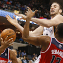 Memphis Grizzlies center Kosta Koufos (41) loses a rebound to Washington Wizards forward Trevor Ariza, left, and center Kevin Seraphin (13) in the second half of an NBA basketball game, Tuesday, Feb. 11, 2014, in Memphis, Tenn. The Grizzlies won 92-89 The