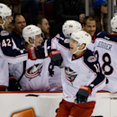 Columbus Blue Jackets' Matt Calvert, right, celebrates his goal against the Vancouver Canucks during first-period NHL hockey game action in Vancouver, British Columbia, Friday, Nov. 22, 2013 The Associated Press