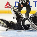 Los Angeles Kings goalie Jonathan Quick stops a shot by St. Louis Blues right wing Vladimir Tarasenko, of Russia, to with the game during an overtime shootout in an NHL hockey game, Thursday, Oct. 16, 2014, in Los Angeles The Associated Press