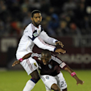 Colorado Rapids midfielder Sanna Nyassi (23) is tripped by Real Salt Lake midfielder Yordany Alvarez (14) during the first half of an MLS soccer game in Commerce City, Colo., Friday, Oct. 14, 2011. (AP Photo/Jack Dempsey)