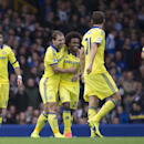 Chelsea's Branislav Ivanovic, centre left, celebrates with teammates after scoring against Everton during their English Premier League soccer match at Goodison Park Stadium, Liverpool, England, Saturday Aug. 30, 2014
