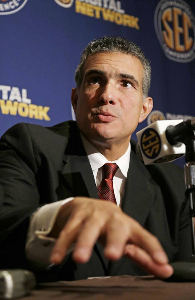 South Carolina coach Frank Martin talks with reporters during Southeastern Conference NCAA college basketball media day in Birmingham, Ala., Thursday, Oct. 17, 2013