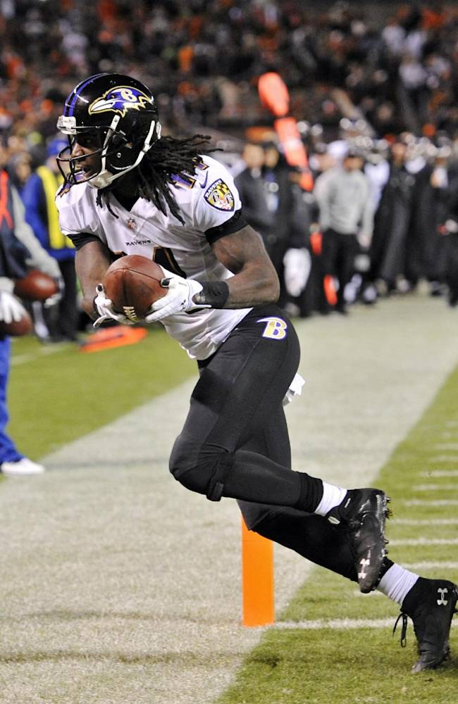 Baltimore Ravens wide receiver Marlon Brown crosses the goal line on a 7-yard touchdown reception against the Cleveland Browns in the fourth quarter of an NFL football game Sunday, Nov. 3, 2013