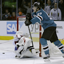 San Jose Sharks center Tommy Wingels (57) scores a goal past Montreal Canadiens goalie Peter Budaj, (30), of the Czech Republic, during the first period of an NHL hockey game on Tuesday, March 8, 2014, in San Jose, Calif The Associated Press
