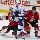 Tampa Bay Lightning center Alex Killorn squeezes between Ottawa Senators goalie Robin Lehner and defenseman Marc Methot during the first period of an NHL hockey game Thursday, March 20, 2014, in Ottawa The Associated Press