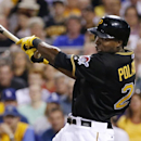 Pittsburgh Pirates' Gregory Polanco (25) drives in two runs with a bases loaded single off Los Angeles Dodgers relief pitcher Jamey Wright during the sixth inning of a baseball game in Pittsburgh Tuesday, July 22, 2014. (AP Photo)