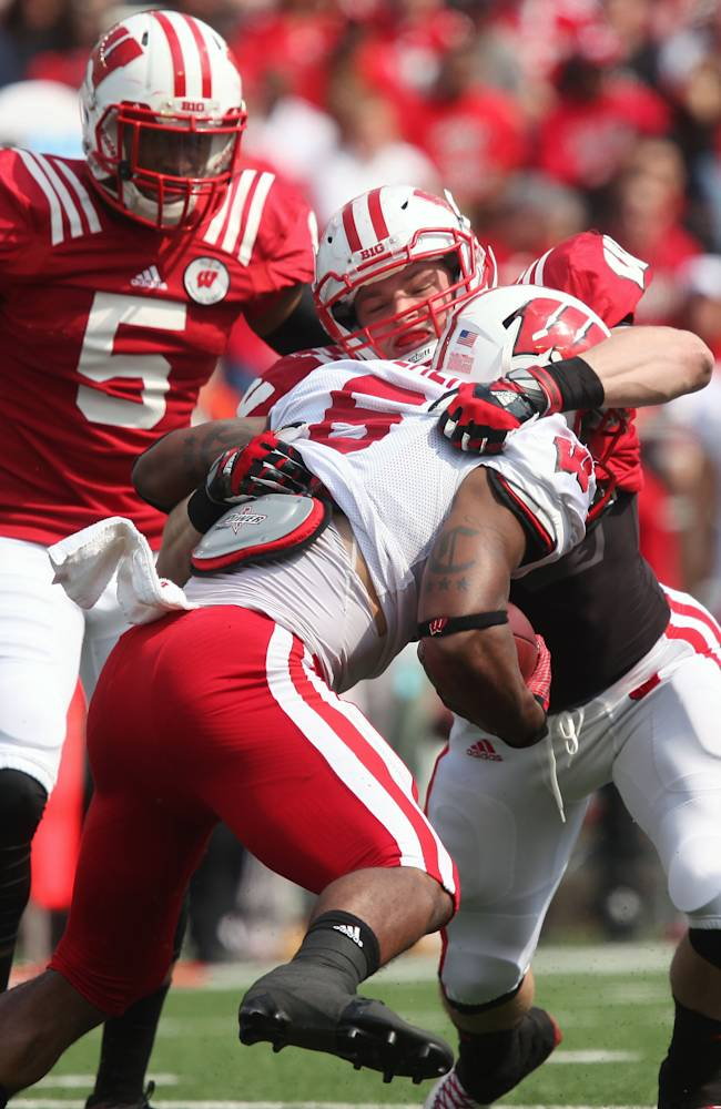 Wisconsin sophomore Vince Biegel attempts to take down teammate sophomore Corey Clement (6) in the first half of a spring game at Camp Randall Stadium in Madison, Wis., Saturday, April 12, 2014