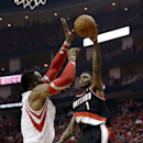 Portland Trail Blazers' Dorell Wright (1) passes the ball as Houston Rockets' Dwight Howard defends during the second quarter in Game 2 of an opening-round NBA basketball playoff series Wednesday, April 23, 2014, in Houston The Associated Press