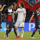 Chelsea's David Luiz, second right, walks past Paris Saint-Germain's Javier Pastore at the end of the Champions League quarterfinal first leg soccer match between Paris Saint-Germain and Chelsea at Parc des Princes stadium in Paris, Wednesday, April 2, 2