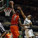 Syracuse's C.J. Fair, left, dunks past South Florida's Anthony Collins during the first half of an NCAA college basketball game Sunday, Jan. 6, 2013, in Tampa, Fla. (AP Photo/Mike Carlson)