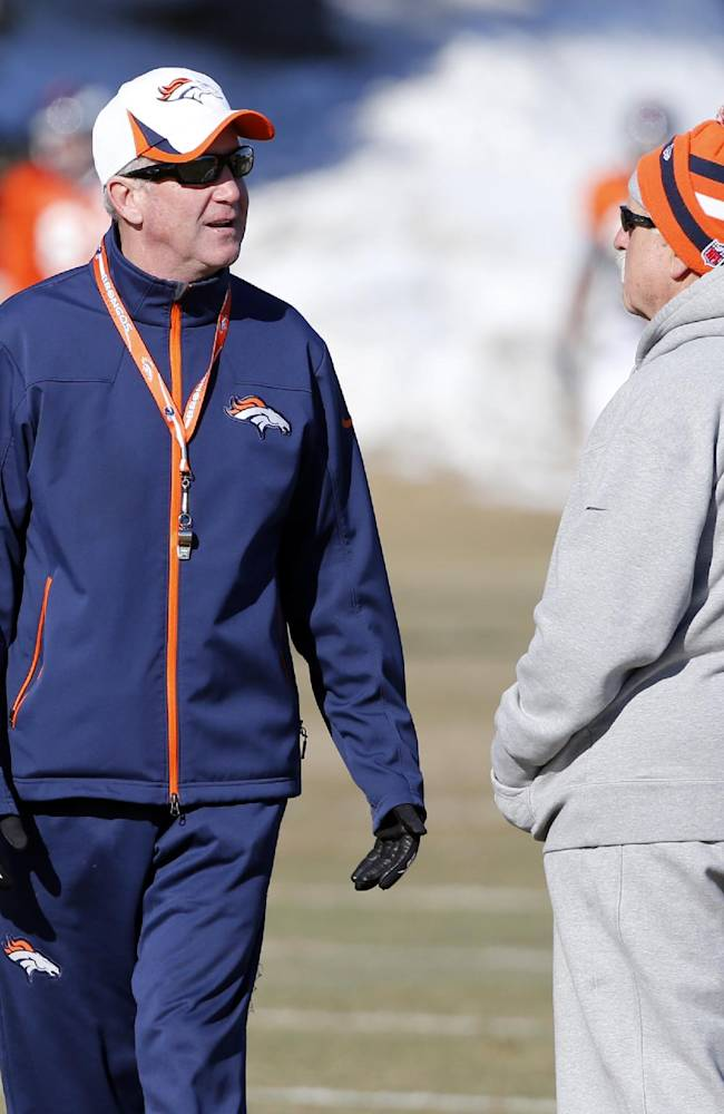 Denver Broncos head coach John Fox, left, talks with offensive consultant Alex Gibbs at practice for the football team's NFL playoff game against the San Diego Chargers at the Broncos training facility in Englewood, Colo., on Wednesday, Jan. 8, 2014