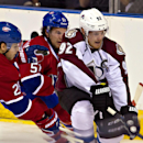 Montreal Canadiens' Nathan Beaulieu (28) and David Desharnais vie for the puck against Colorado Rockies' Gabriel Landeskog during the first period of an NHL preseason hockey game Friday, Sept. 26, 2014, in Quebec City. The Associated Press