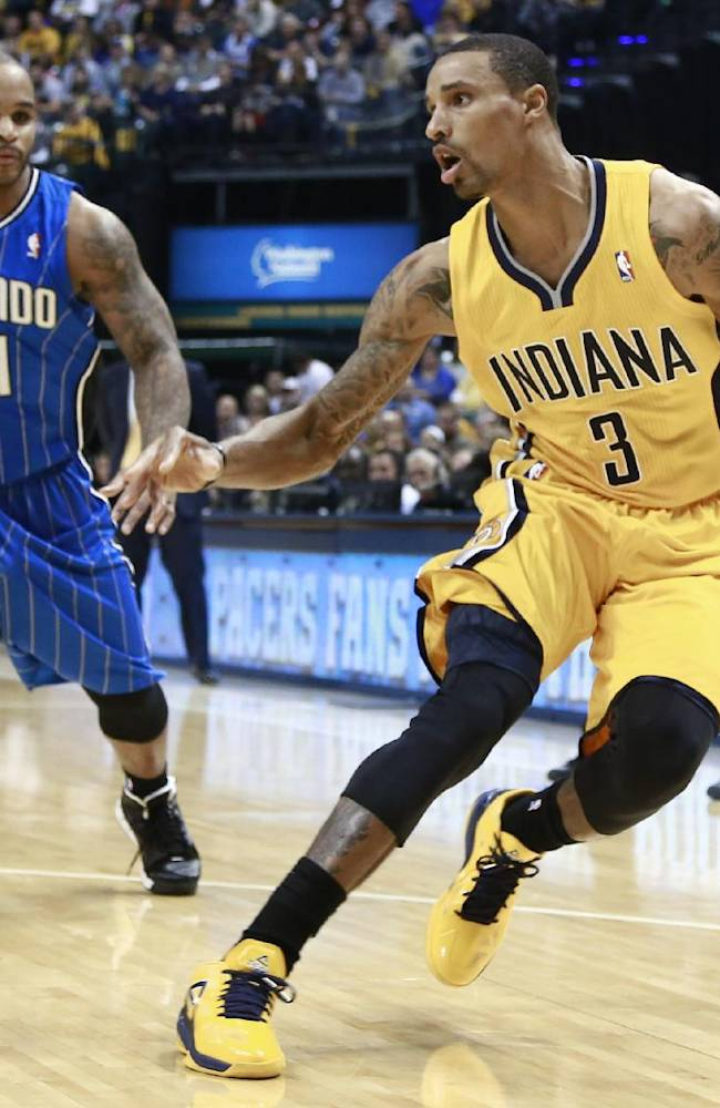 Indiana Pacers guard George Hill (3) controls the basketball near Orlando Magic guard Jameer Nelson in the second half of an NBA basketball game in Indianapolis, Tuesday, Oct. 29, 2013. Indiana won 97-87