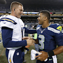 Seattle Seahawks quarterback Russell Wilson (3) visits with San Diego Chargers quarterback Philip Rivers after the Seahawks defeated the Chargers 41-14 in a preseason NFL football game, Friday, Aug. 15, 2014, in Seattle The Associated Press