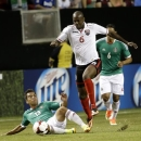 Mexico's Adrian Aldrette (13) kicks the ball away from Trinidad & Tobago's Darell Cyrus during the first half in the quarterfinals of the CONCACAF Gold Cup soccer tournament, Saturday, July 20, 2013, in Atlanta. (AP Photo/John Bazemore)