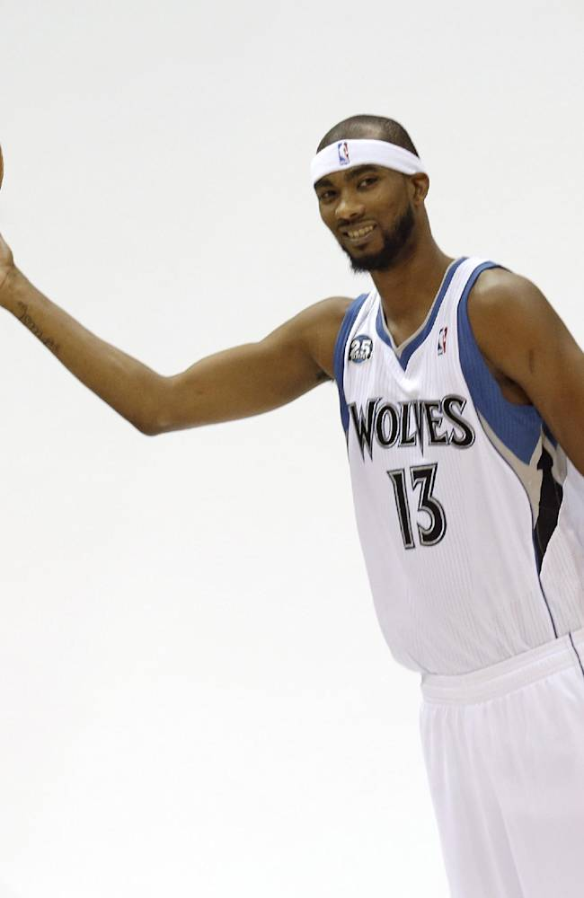 Minnesota Timberwolves' Corey Brewer  poses for the team photographer during the NBA basketball team's media day, Monday, Sept. 30, 2013, in Minneapolis