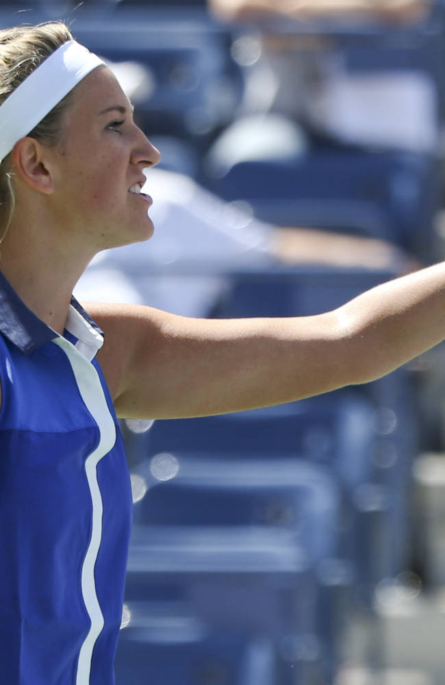 Victoria Azarenka, of Belarus, motions to the chair umpire after a shot against Ekaterina Makarova, of Russia, during the quarterfinals of the 2014 U.S. Open tennis tournament, Wednesday, Sept. 3, 2014, in New York