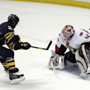 Buffalo Sabres left winger Matt Moulson (26) scores the game-winning goal against Ottawa Senators goaltender Robin Lehner (40) during a shootout in an NHL hockey game Monday, Dec. 15, 2014, in Buffalo, N.Y. Buffalo won 5-4 The Associated Press