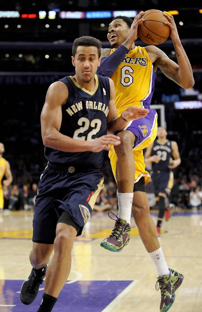 Los Angeles Lakers guard Kent Bazemore (6) attempts to get by New Orleans Pelicans guard Brian Roberts (22) as he drives to the basket in the second half of an NBA basketball game, Tuesday, March 4, 2014, in Los Angeles. The Pelicans won 132 to 125