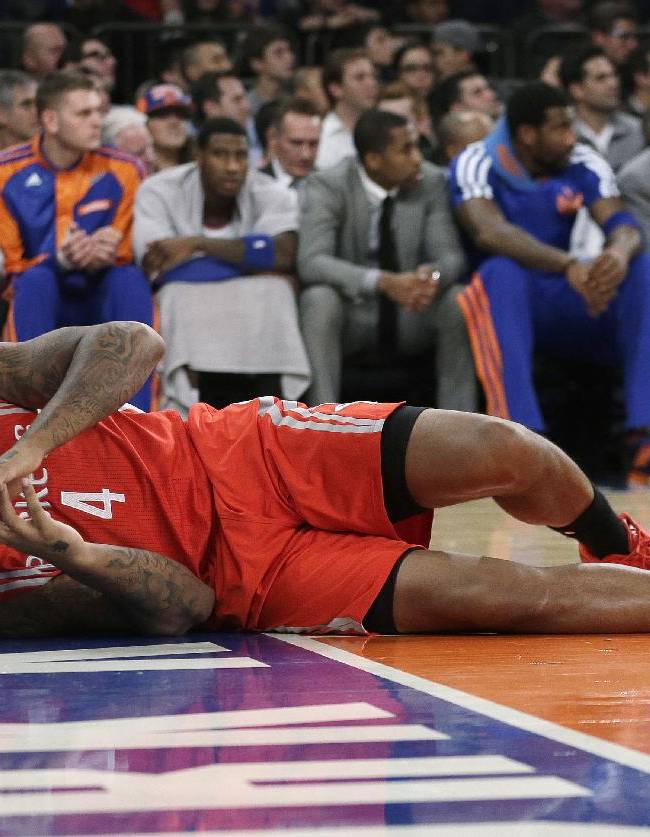 Houston Rockets' Greg Smith reacts lies on the court after an injury during the first half of the Rockets' NBA basketball game against the New York Knicks on Thursday, Nov. 14, 2013, in New York