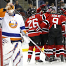 New Jersey Devils players celebrate after center Travis Zajac (19) scored a goal against New York Islanders goalie Jaroslav Halak, left, of Slovakia, during the second period of an NHL hockey game, Friday, Jan. 9, 2015, in Newark, N.J The Associated Press