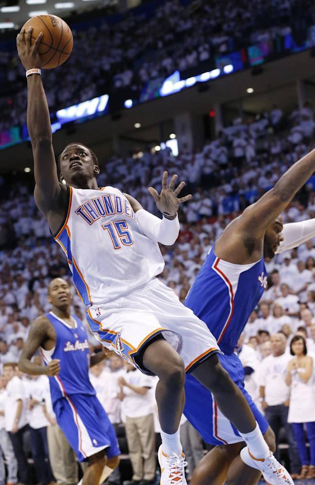 Oklahoma City Thunder guard Reggie Jackson (15) shoots in front of Los Angeles Clippers forward Glen Davis in the second half of Game 5 of the Western Conference semifinal NBA basketball playoff series in Oklahoma City, Tuesday, May 13, 2014. Oklahoma City won 105-104. (AP Photo)