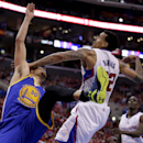 Los Angeles Clippers forward Matt Barnes, right, fouls Golden State Warriors guard Stephen Curry during the second half in Game 2 of an opening-round NBA basketball playoff series in Los Angeles, Monday, April 21, 2014 The Associated Press
