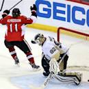 Ottawa Senators' Daniel Alfredsson (11) celebrates as he scores on Pittsburgh Penguins goaltender Tomas Vokoun (92) during the third period of Game 4 of the Eastern Conference Stanley Cup semifinal NHL hockey series on Sunday, May 19, 2013, in Ottawa. (AP Photo/The Canadian Press, Fred Chartrand)