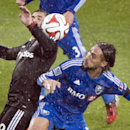 Montreal Impact's Issey Nakajima-Farran, right, and D.C. United's Fabian Espindola battle for the ball during an MLS soccer game action in the rain in Montreal, Saturday, Oct. 25, 2014 The Associated Press